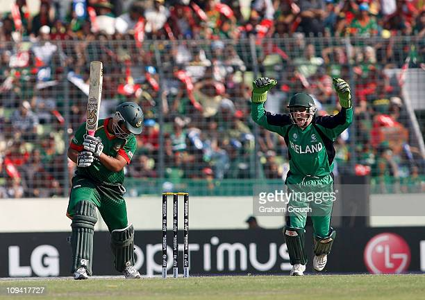 Niall O'Brien of Ireland celebrates the dimissal of Tamim Iqbal of Bangladesh caught by William Porterfield of the bowling of Andre Botha for 44...