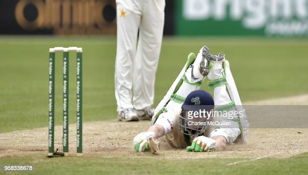 Niall O'Brien of Ireland dives to avoid being run out during the fourth day of the international test cricket match between Ireland and Pakistan on...