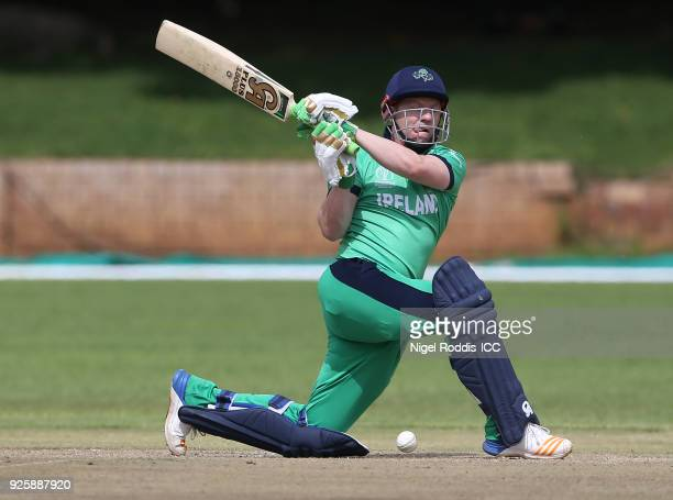 Niall O'Brien of Ireland hits out during the ICC Cricket World Cup Qualifier Warm Up between Scotland and Ireland at Queen's Sports Club on March 1...