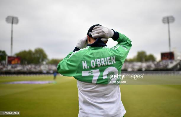 Niall OBrien of Ireland puts on his jersey prior to the Royal London One Day International between England and Ireland at Lord's Cricket Ground on...