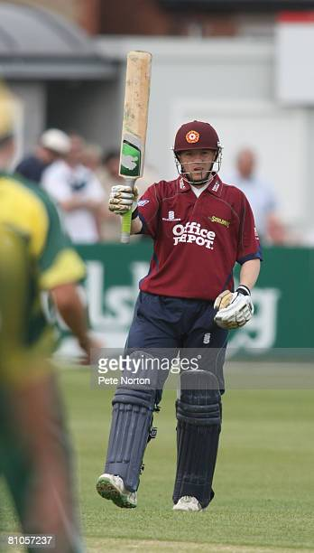 Niall O'Brien of Northamptonshire Steelbacks raises his bat on reaching 50 in his innings of 95 during the Friends Provident Trophy Match between...
