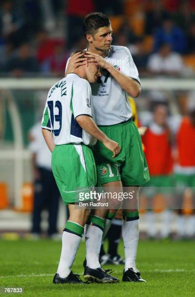 Niall Quinn of the Republic of Ireland consoles teammate David Connolly after he missed a penalty kick in the penalty shootout during the FIFA World...