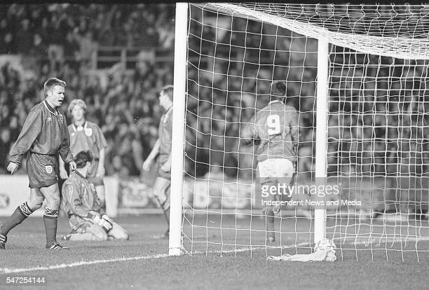 Niall Quinn rushes to congratulate David Kelly after he scored of the Irish goal against England at Landsdowne Road. Following the goal a riot...