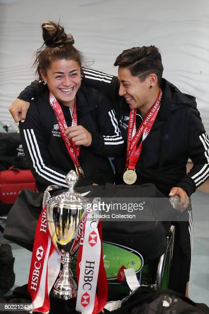 Niall Williams and Crystal Mayes celebrate as the New Zealand Black Ferns arrive at Auckland International Airport with the World Sevens Series...