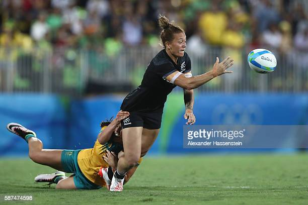 Niall Williams of New Zealand is tackled by Charlotte Caslick of Australia during the Women's Gold Medal Rugby Sevens match between Australia and New...