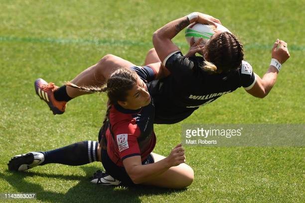Niall Williams of New Zealand is tackled during the pool match between New Zealand and Russia on day one of the HSBC Women's Rugby Sevens Kitakyushu...