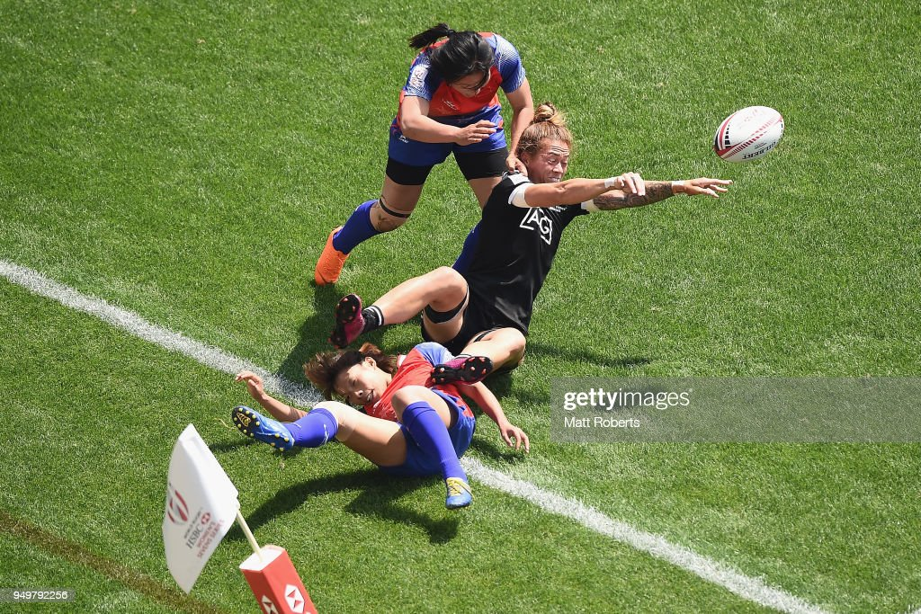 Niall Williams of New Zealand offloads the ball on day two of the HSBC Women's Rugby Sevens Kitakyushu Cup quarter-final match between New Zealand and China at Mikuni World Stadium Kitakyushu on April 22, 2018 in Kitakyushu, Fukuoka, Japan.