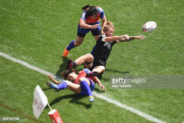 Niall Williams of New Zealand offloads the ball on day two of the HSBC Women's Rugby Sevens Kitakyushu Cup quarterfinal match between New Zealand and...