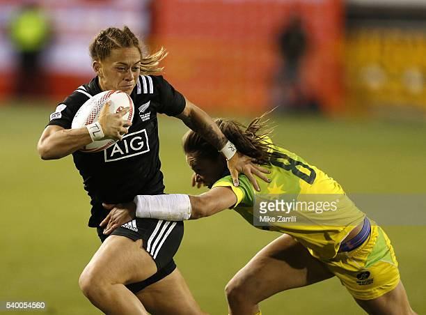 Niall Williams of New Zealand runs with the ball while Chloe Dalton of Australia tries to tackle her during the Final match at Fifth Third Bank...