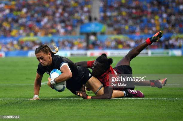 Niall Williams of New Zealand scores a try past Michelle Omondi of Kenya during the Rugby Sevens Women's Pool A match between New Zealand and Kenya...