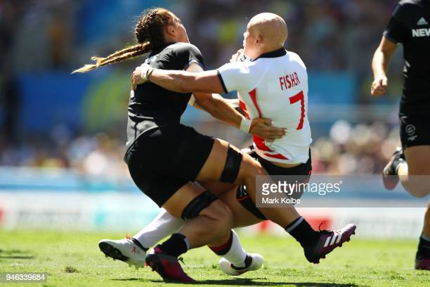 Niall Williams of New Zealand tackles Heather Fisher of England during the women's Rugby Sevens semi final match between New Zealand and England on...