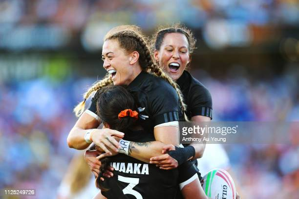 Niall Williams, Tyla Nathan-Wong and Stacey Waaka of the Black Ferns Sevens celebrate after winning against France during day two of the 2019...