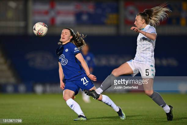 Niamh Charles of Chelsea is tackled by Hannah Short of London City Lionesses during the Vitality Women's FA Cup Fourth Round match between Chelsea v...