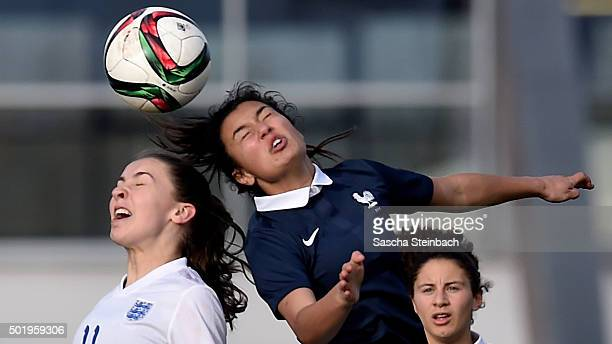 Niamh Charles of England and Solene Champagnac of France battle for a header during the U17 girl's international friendly match between France and...