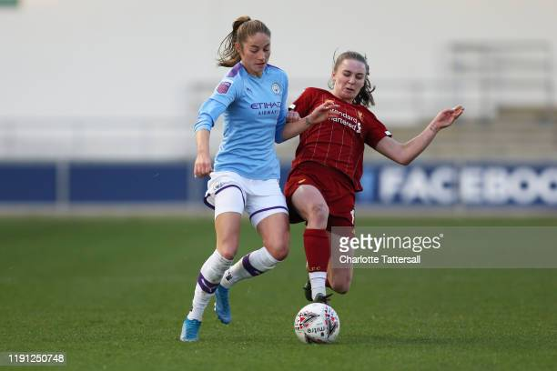 Niamh Charles of Liverpool FC tackles Janine Beckie of Manchester City during the Barclays FA Women's Super League match between Manchester City and...