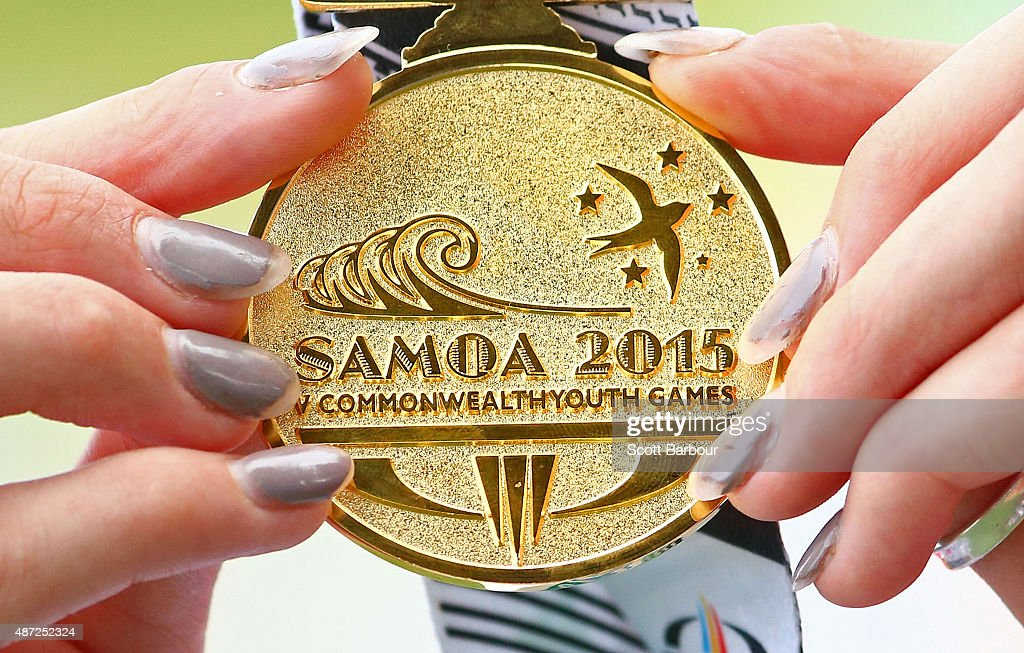 Niamh Emerson of England holds her gold medal after the medal presentation for the Girls High Jump during the Athletics at the Apia Park Sports Complex on day two of the Samoa 2015 Commonwealth Youth Games on September 8, 2015 in Apia, Samoa.