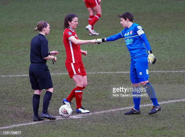 Niamh Fahey of Liverpool Women and Sue Wood of Coventry United with referee Lucy-Anne Briggs at Prenton Park on March 14, 2021 in Birkenhead, England.