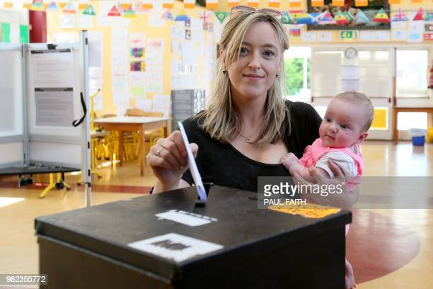 Niamh Gavin poses for a photograph with her 5yearold daughter Fiadh as she casts her vote in the Irish referendum on liberalising abortion law at St...