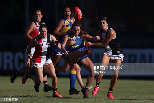 Niamh Kelly of the Eagles kicks under pressure from Georgia Patrikios of the Saints during the 2021 AFLW Round 09 match between the West Coast Eagles...