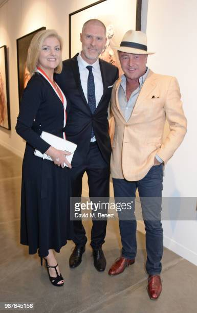 Niamh O'Brien JeanDavid Malat and Michael Flatley attend the Grand Opening of JD Malat Gallery in Mayfair on June 5 2018 in London England