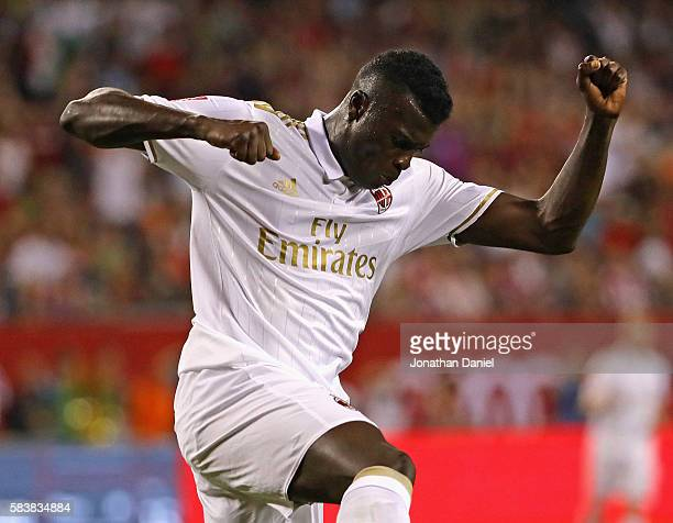 Niang Mbaye of AC Milan celebrates his first half score against FC Bayern Munich during a friendly match in the International Champions Cup 2016 at...