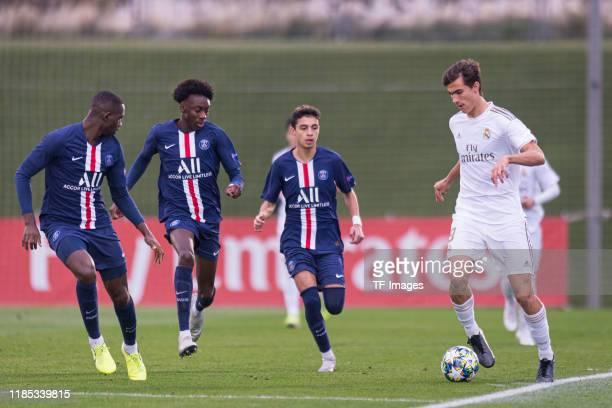 Nianzou Kouassi of Paris SaintGermain Maxen Kapo of Paris SaintGermain Kays RuizAtil of Paris SaintGermain and Pedro Ruiz of Real Madrid battle for...