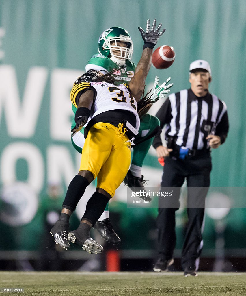 Nic Demski #9 of the Saskatchewan Roughriders make a catch behind the out stretched arm of Dominique Ellis #31 of the Hamilton Tiger-Cats in first half action of the game between the Hamilton Tiger-Cats and Saskatchewan Roughriders at Mosaic Stadium on September 24, 2016 in Regina, Canada.