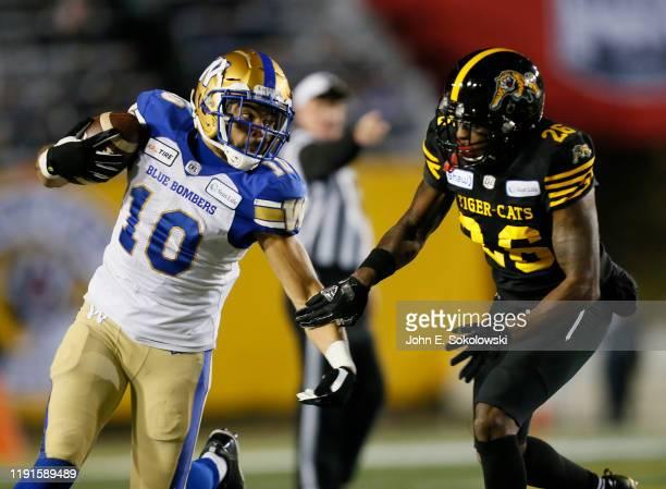 Nic Demski of the Winnipeg Blue Bombers tries to get around Cariel Brooks at McMahon Stadium on November 24, 2019 in Calgary, Canada. Winnipeg Blue...