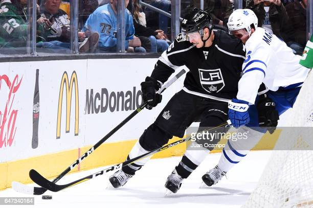 Nic Dowd of the Los Angeles Kings skates with the puck with pressure from Alexey Marchenko of the Toronto Maple Leafs during the game on March 2 2017...