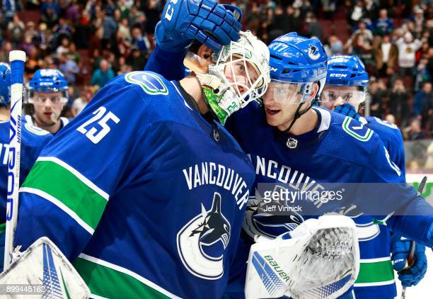 Nic Dowd of the Vancouver Canucks congratulates teammate Jacob Markstrom of the Vancouver Canucks after their win during their NHL game against the...