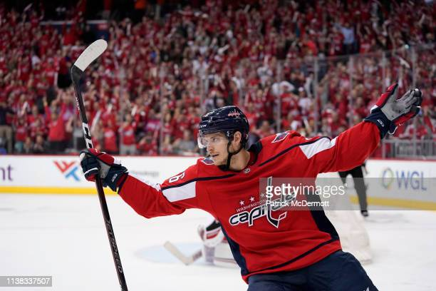 Nic Dowd of the Washington Capitals celebrates after scoring a goal against Petr Mrazek of the Carolina Hurricanes on a penalty shot in the third...