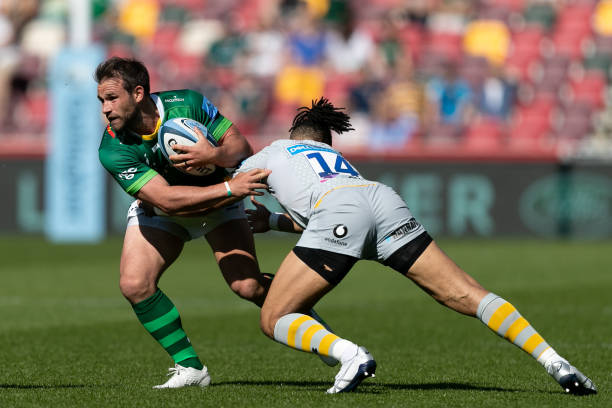 Nic Groom of London Irish is tackled by Marcus Watson of Wasps during the Gallagher Premiership match between London Irish and Wasps at the Brentford Community Stadium, Brentford on Saturday 5th June 2021. (Photo by Juan Gasparini/MI News/NurPhoto via Getty Images)