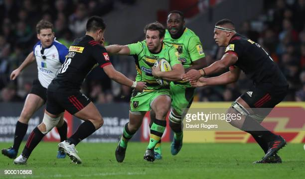 Nic Groom of Northampton takes on Marcus Smith and Ben Glynn during the Aviva Premiership Big Game 10 match between Harlequins and Northampton Saints...