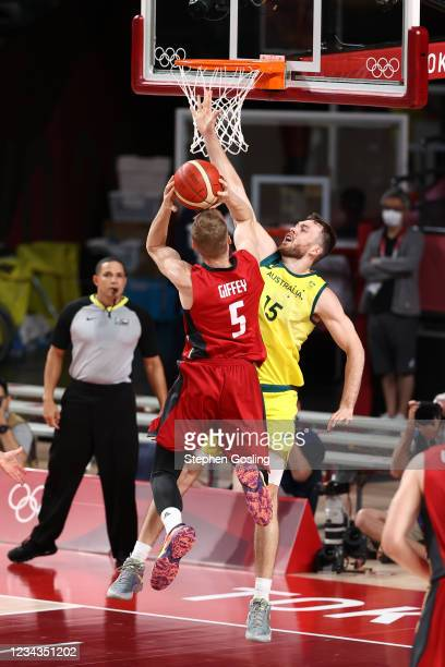 Nic Kay of the Australia Men's National Team attempts to block the ball during the game against the Germany Men's National Team during the 2020 Tokyo...