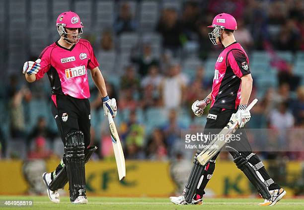 Nic Maddinson and Moises Henriques of the Sixers celebrate victory in the Big Bash League match between Sydney Thunder and the Sydney Sixers at ANZ...