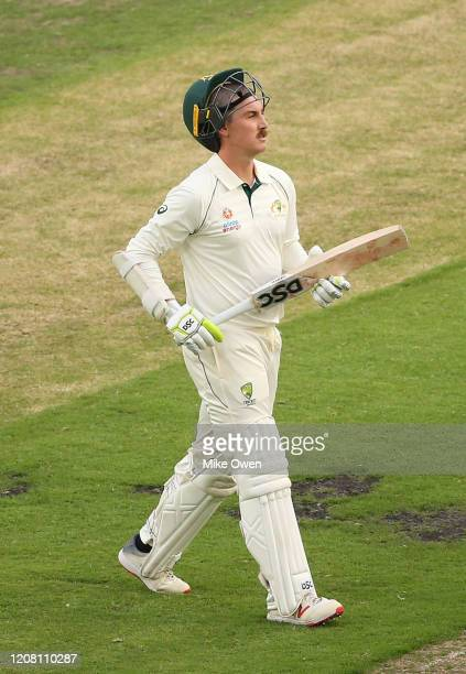 Nic Maddinson of Australia A leaves the field of play after being dismissed during the Four Day match between Australia A and the England Lions at...