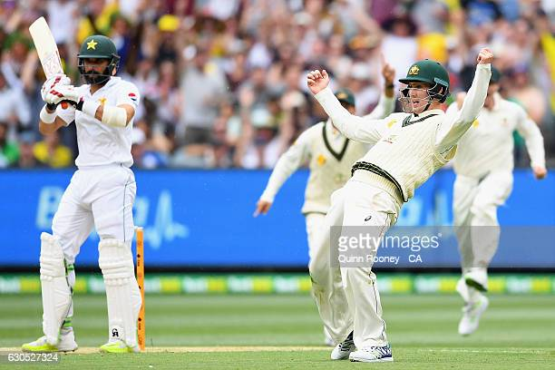 Nic Maddinson of Australia celebrates taking a catch to dismiss MisbahulHaq of Pakistan during day one of the Second Test match between Australia and...