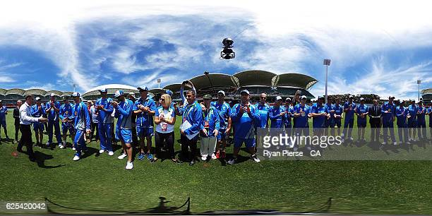 Nic Maddinson of Australia recieves his Baggy Green Cap from former Test Cricketer Simon Katich during day one of the Third Test match between...