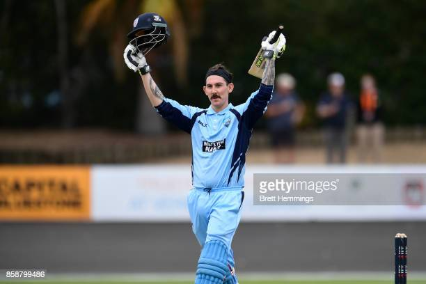 Nic Maddinson of NSW celebrates after scoring a century during the JLT One Day Cup match between New South Wales and the Cricket Australia XI at...