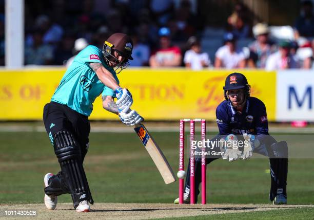 Nic Maddinson of Surrey plays a shot as wicketkeeper Adam Wheater of Essex looks on during the Vitality Blast T20 match between Essex Eagles and...