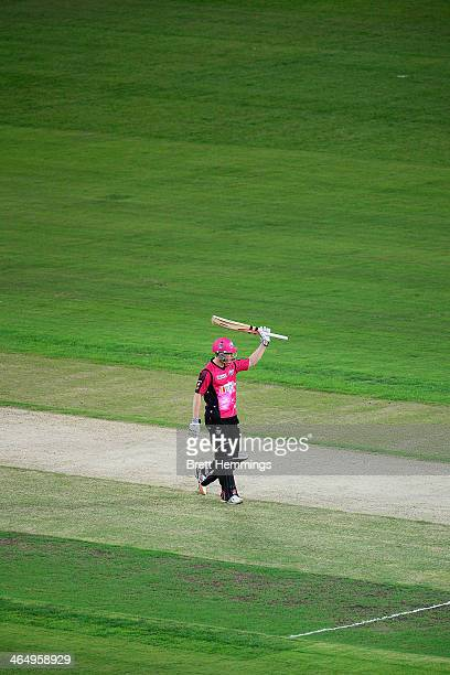 Nic Maddinson of the Sixers celebrates after reaching his half century during the Big Bash League match between Sydney Thunder and the Sydney Sixers...