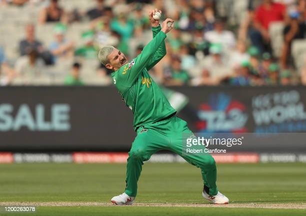 Nic Maddinson of the Stars takes a catch off his own bowling to dismiss Cameron Bancroft of the Perth Scorchers during the Big Bash League match...
