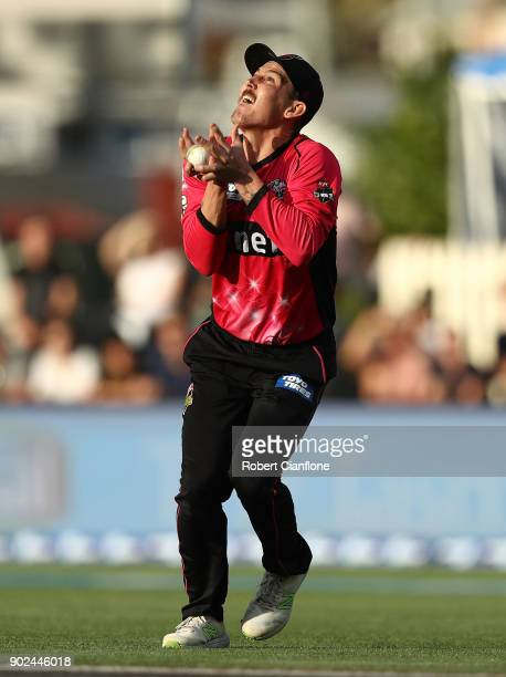 Nic Maddinson of the Sydney Sixers takes a catch to dismiss Ben McDermott of the Hurricanes during the Big Bash League match between the Hobart...