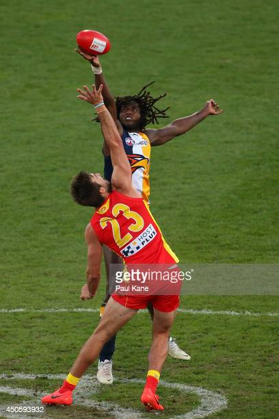 Nic Naitanui of the Eagles and Charlie Dixon of the Suns contest the ruck during the round 13 AFL match between the West Coast Eagles and the Gold...