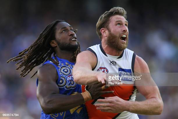 Nic Naitanui of the Eagles and Dawson Simpson of the Giants during the round 16 AFL match between the West Coast Eagles and the Greater Western...