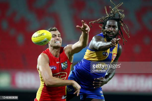Nic Naitanui of the Eagles and Jarrod Witts of the Suns compete for the ball during the round 2 AFL match between the Gold Coast Suns and the West...
