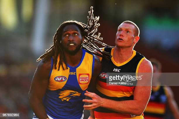 Nic Naitanui of the Eagles and Sam Jacobs of the Crows compete for the ball during the round 15 AFL match between the Adelaide Crows and the West...