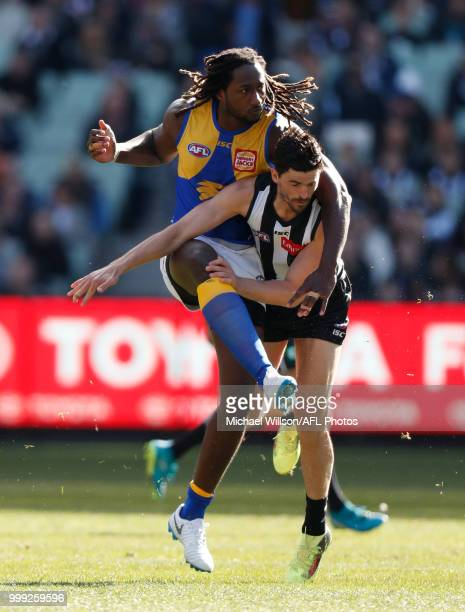 Nic Naitanui of the Eagles and Scott Pendlebury of the Magpies compete for the ball during the 2018 AFL round 17 match between the Collingwood...