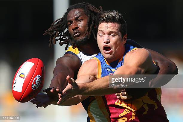 Nic Naitanui of the Eagles and Stefan Martin of the Lions compete for the ball during the round four AFL match between the Brisbane Lions and the...