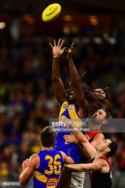 Nic Naitanui of the Eagles attempts a mark during the 2018 AFL round 14 match between the West Coast Eagles and the Essendon Bombers at Optus Stadium...
